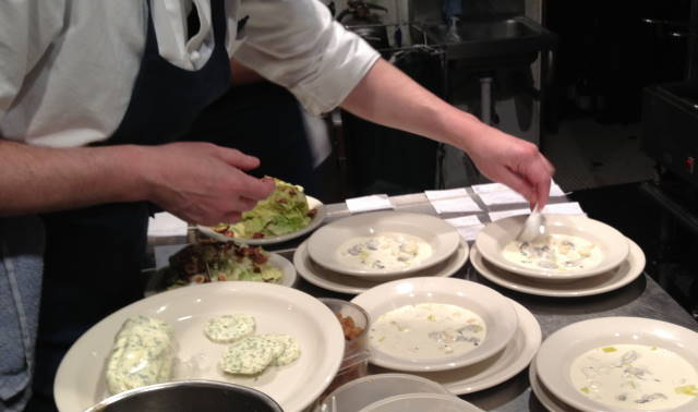 Preparing Totten Inlet oyster potage with celery root, leeks, Montana river paddlefish caviar and butter fried croutons.