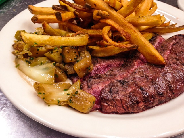 orthwest Grass Fed beef skirt steak, with braised cabbage and apples and roasted chestnut sauce, with pommes frite