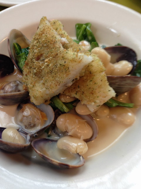Fish of the day baked with an herb crust, with white beans, Penn Cove clams, roasted garlic and spinach.