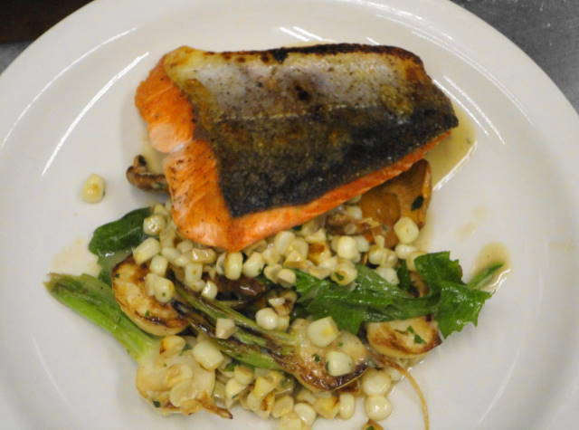Local troll caught salmon filet served on a saute of sweet corn, chanterelles, turnips, turnip greens and finished with persillade butter.