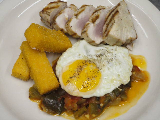 Grilled Washington albacore tuna loin served with piperade, gascon-style corn cakes and a fried farm egg.