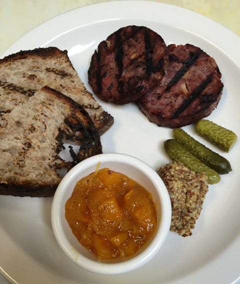 Grilled duck-pork sausage served with pumpkin confiture, cornichons, grain mustard and grilled country bread