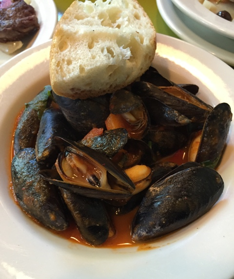 Penn Cove mussels simmered with Basque-style sweet pepper compote and piment d'Espelette, with grilled baguette.