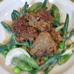 Butter milk fried chicken livers on a salad of green beans, snow peas, peas and roasted shallot dressing