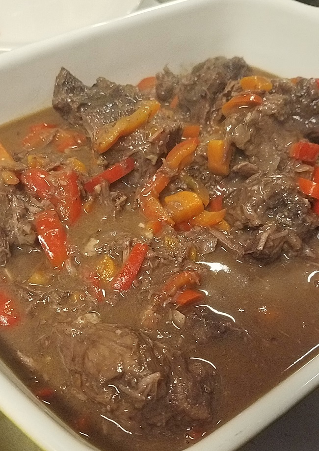 Bull from Old Chaser Farm on Vashon Island, simmered with red wine, orange peel and sweet peppers, served with brown rice